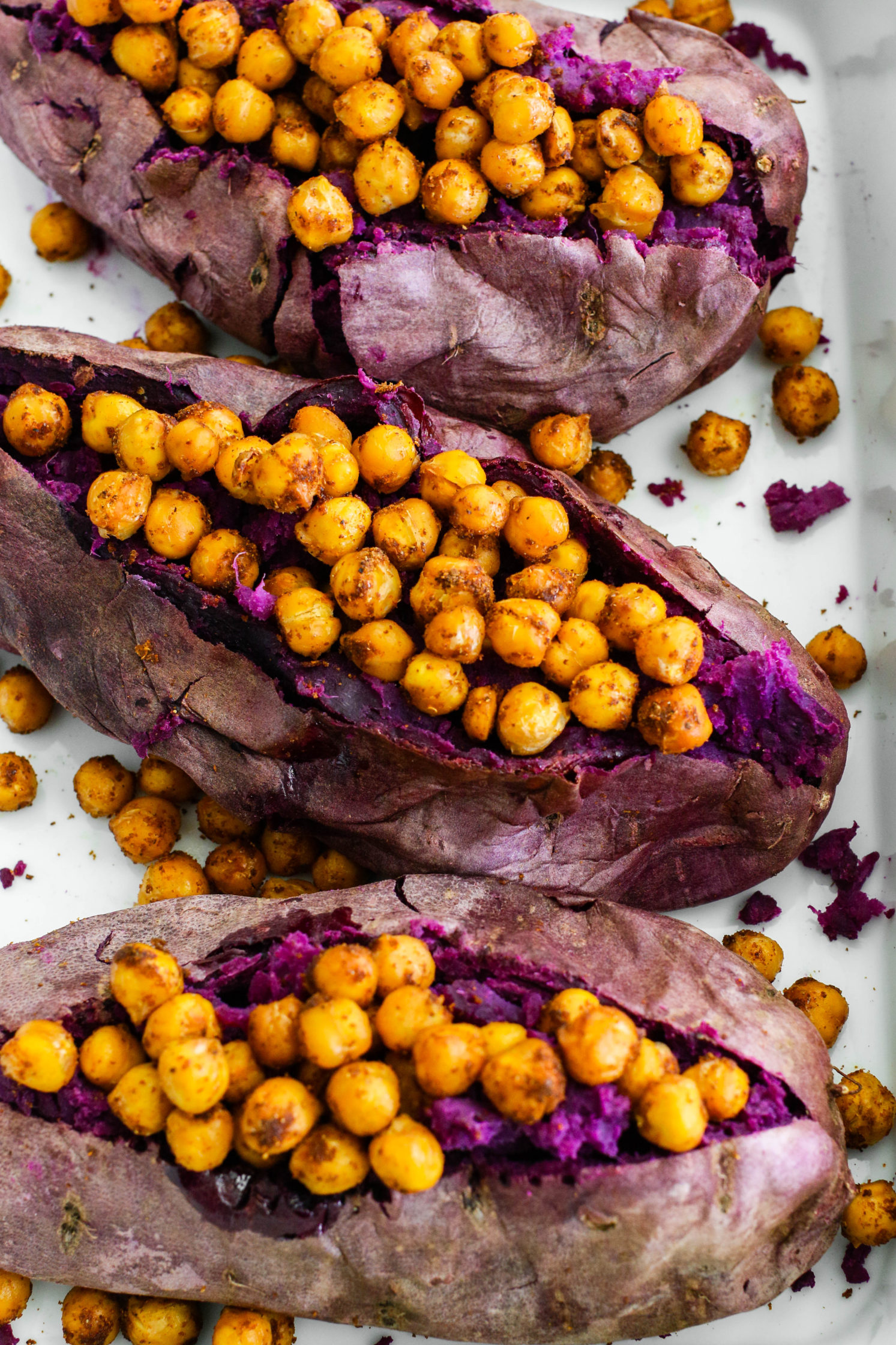 Stuffed Purple Sweet Potatoes with Tandoori Chickpeas & Turmeric Tahini