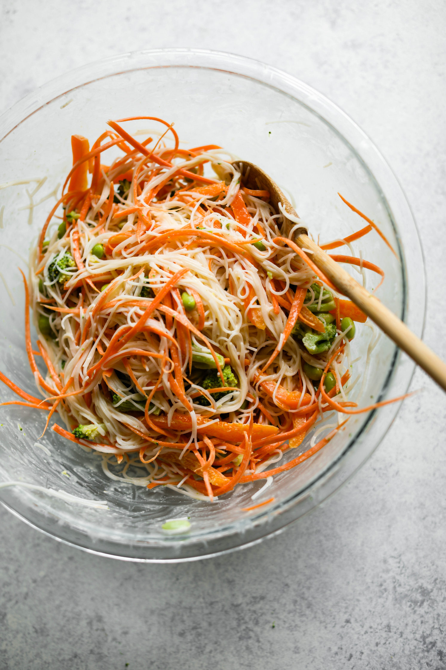 Rainbow Rice Noodle Bowls with Miso Tahini Dressing mixed in bowl