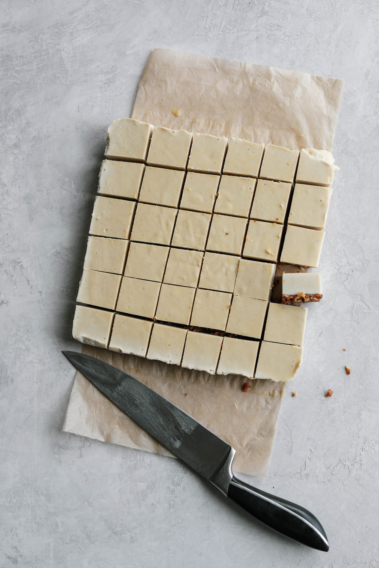 Chocolate Dipped Cashew Cheesecake Bites by Flora & Vino cut with knife