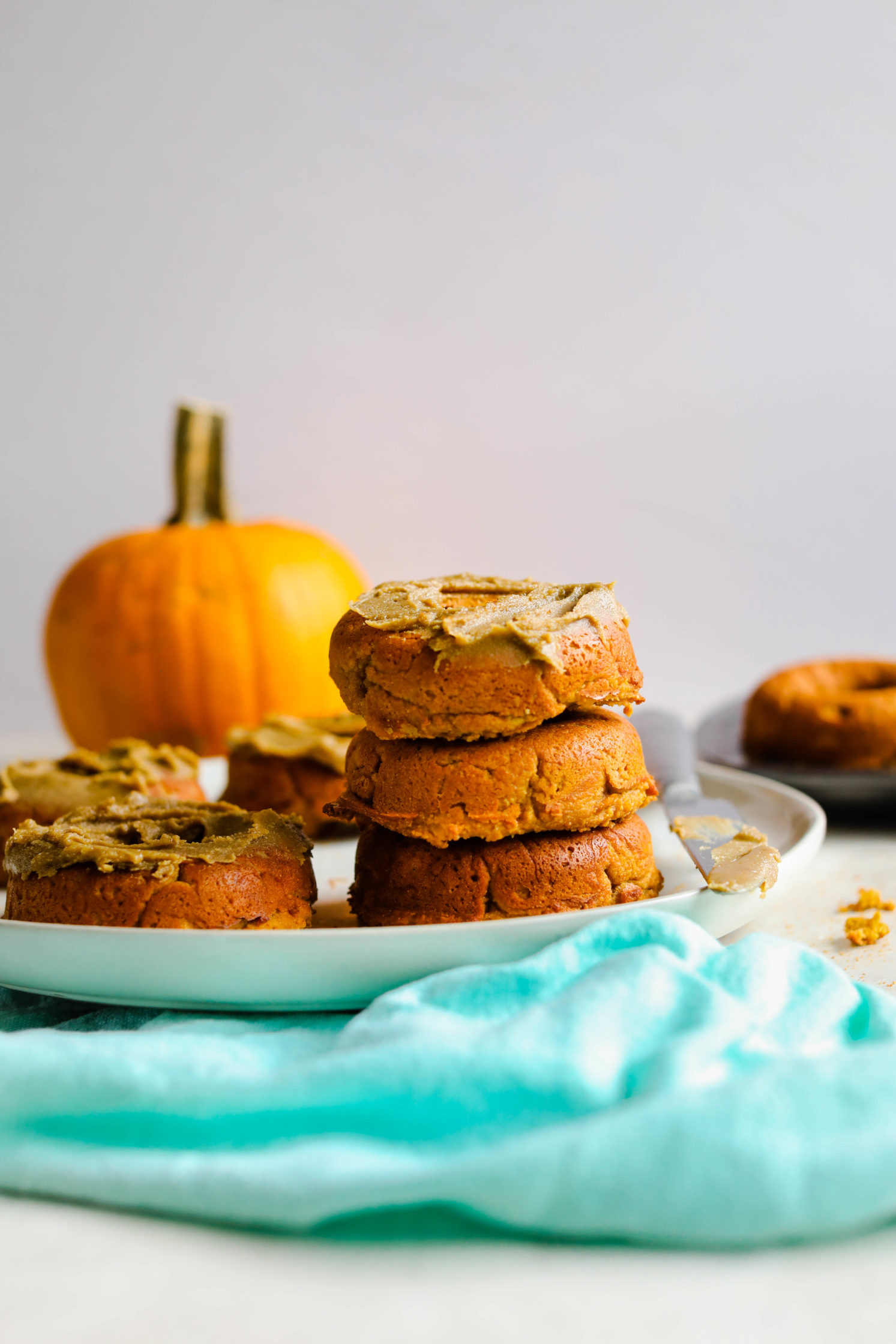 Vegan Pumpkin Donuts with SunButter Maple Frosting by Flora & Vino