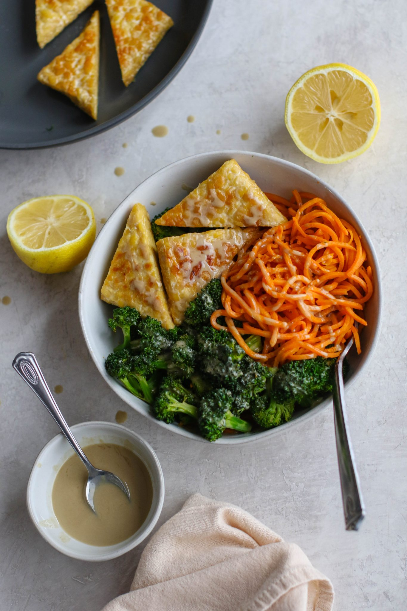 Tahini Tempeh, Sweet Potato Noodle, & Broccoli Bowl by Flora & Vino