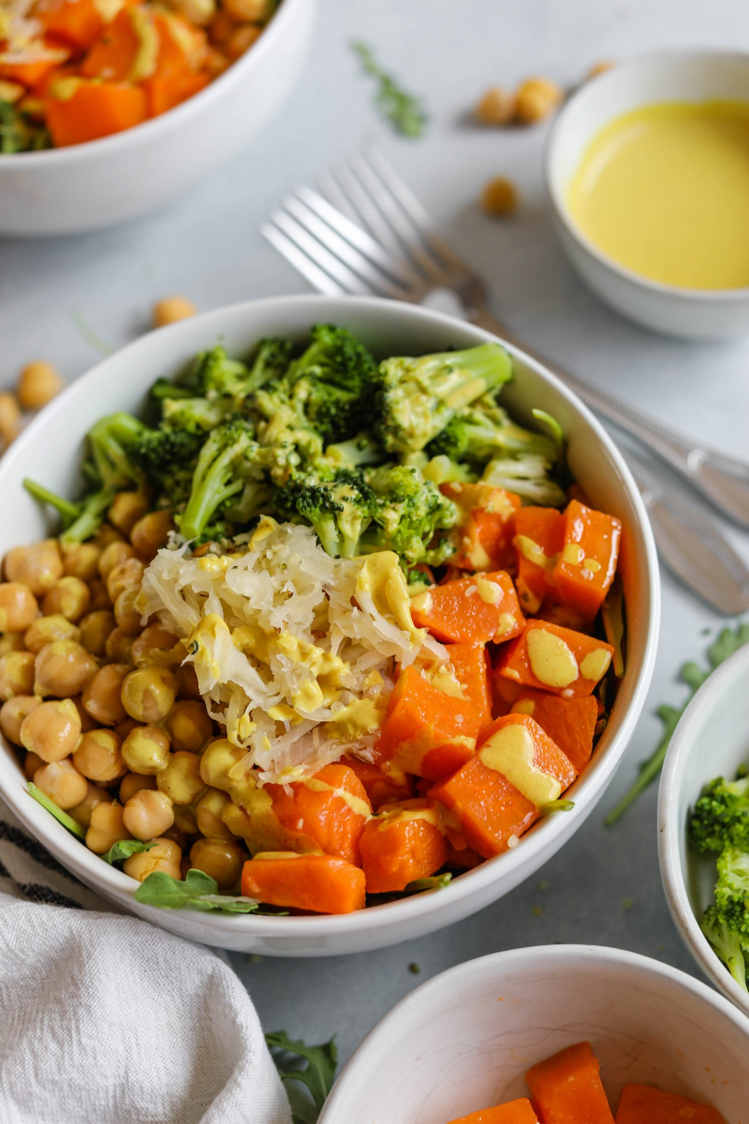 Chickpea Meal Prep Bowl with Turmeric Tahini Dressing by Flora & Vino