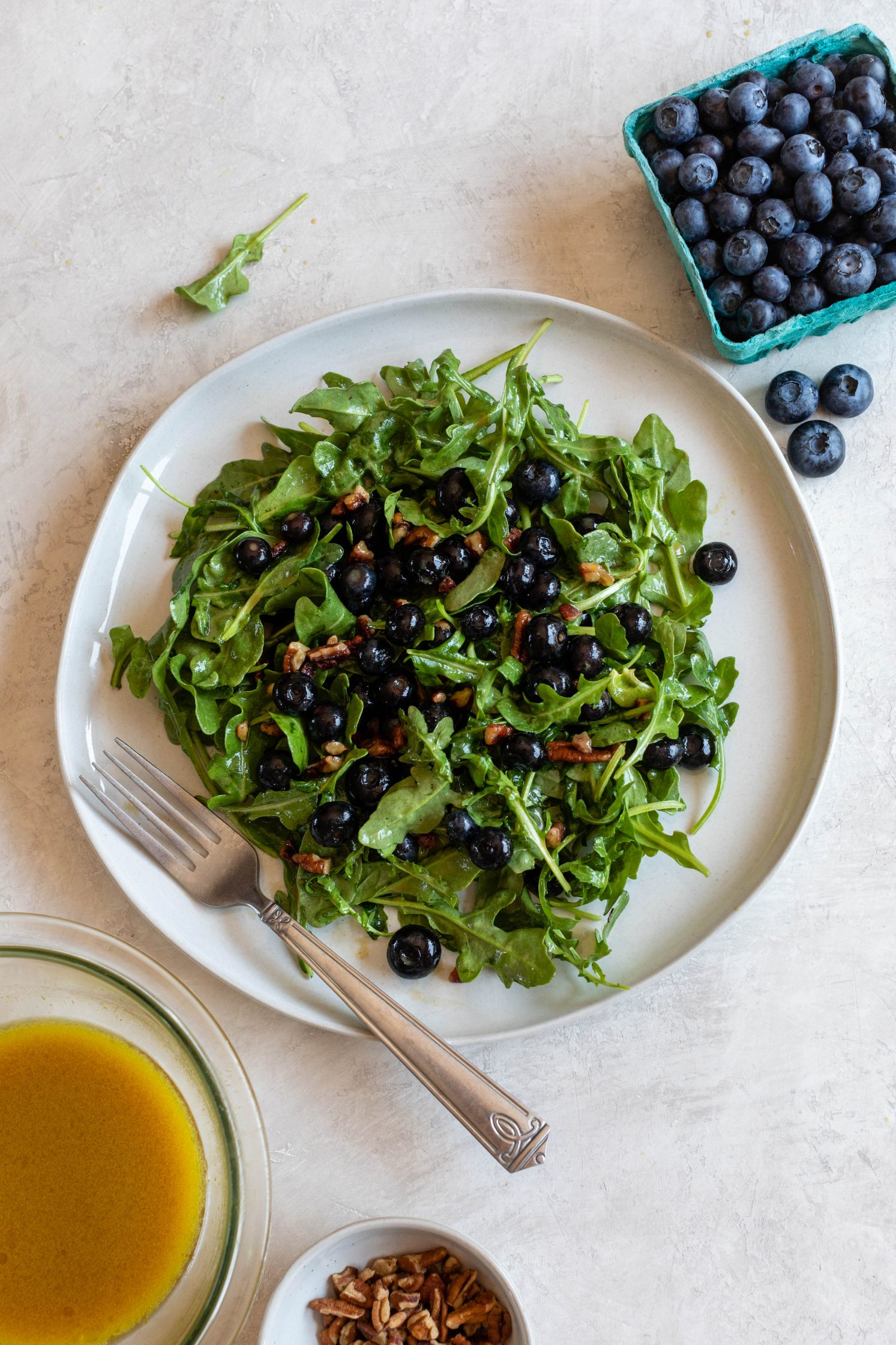 Blueberry Pecan Arugula Salad with Blueberry Vinaigrette by Flora & Vino